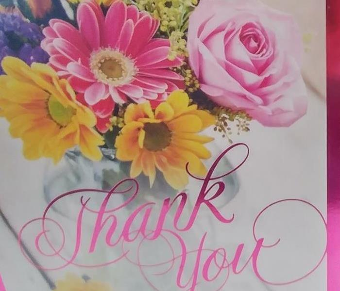 Front cover of Thank You card with vase of flowers on it